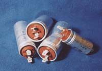 Capacitors for fluorescent lamps