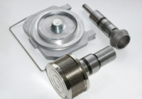 Production of parts for textile machines